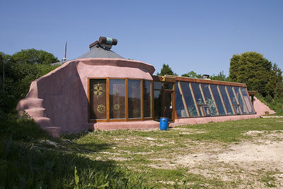 The design used with most earthships. A large series of windows  and the use of tires characterize the earth sheltered building